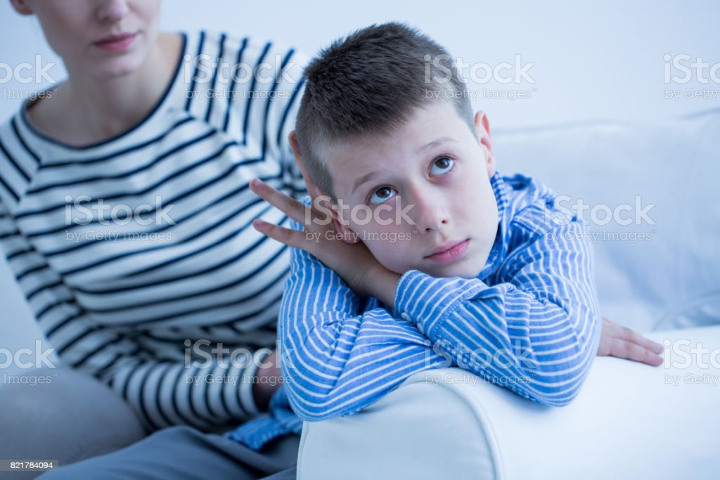 Sad boy and his mom stock photo