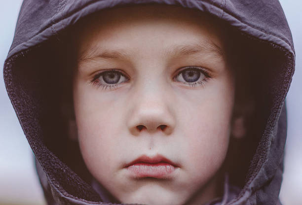 sad boy in a black hood. close-up - Photo