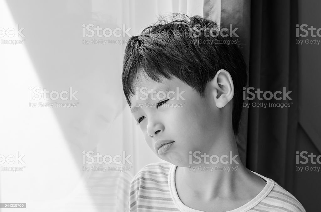 Sad Boy Looking Out Of Window Stock Photo Download Image Now Istock