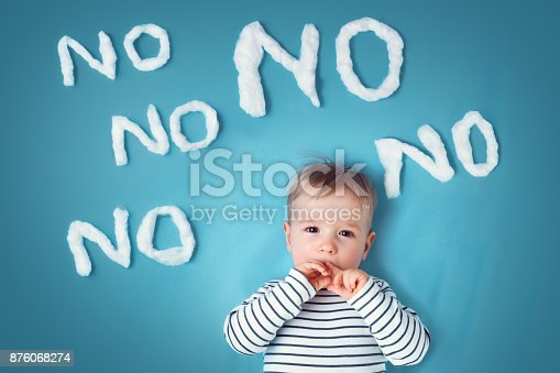 istock sad boy on blue blanket background 876068274