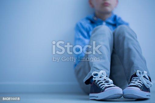 istock Sad boy sits alone 840814418