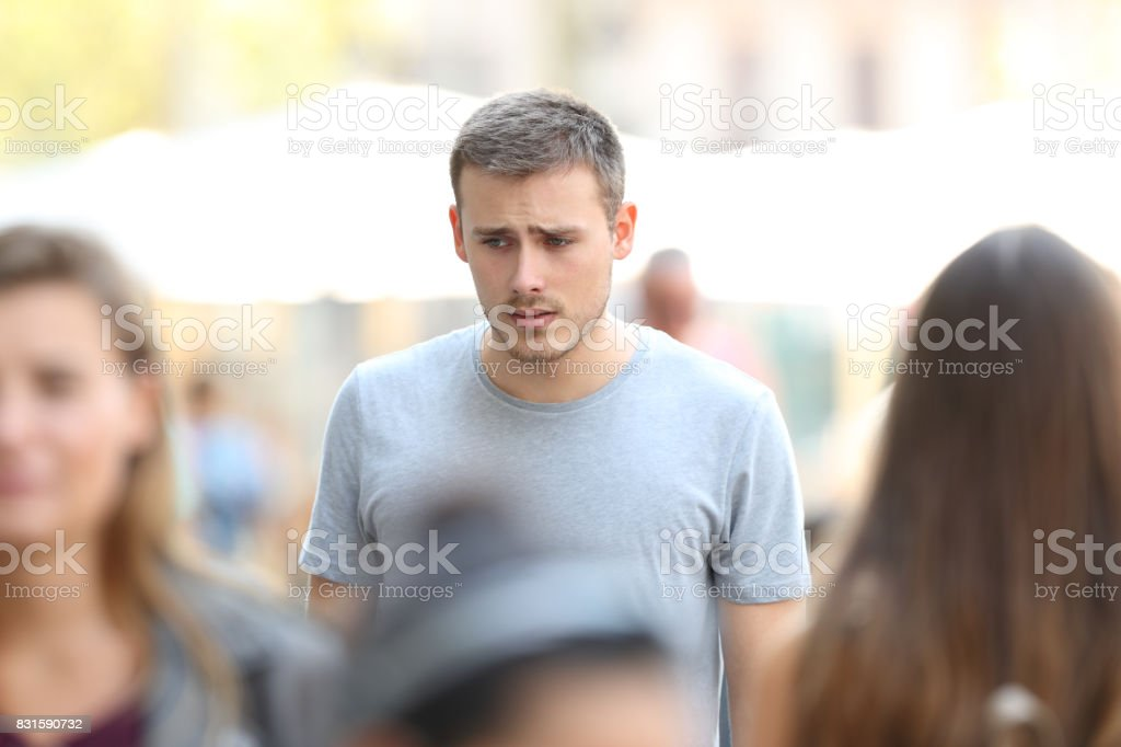 Sad boy walking on the street stock photo