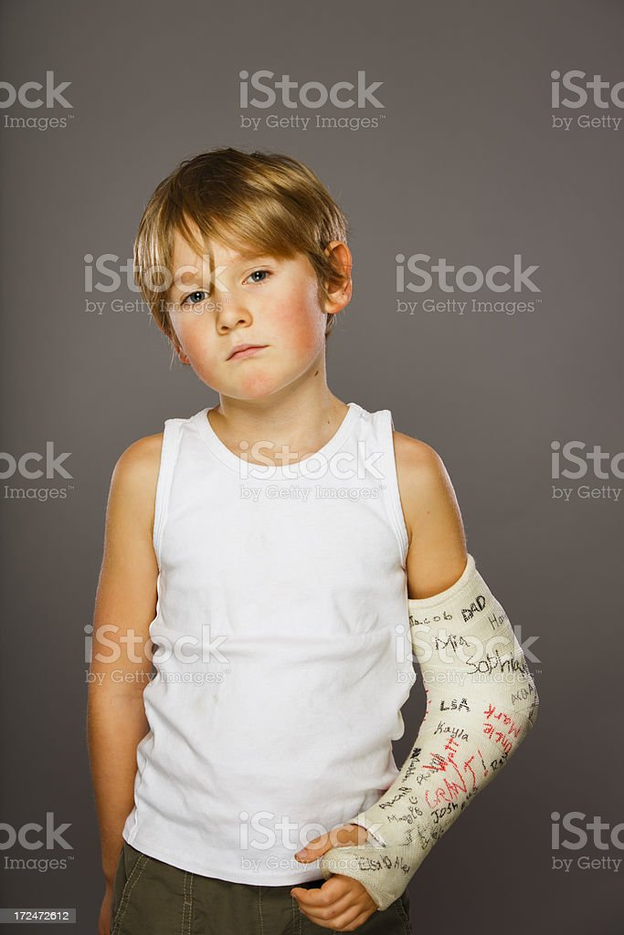 Sad Boy with Broken Arm stock photo