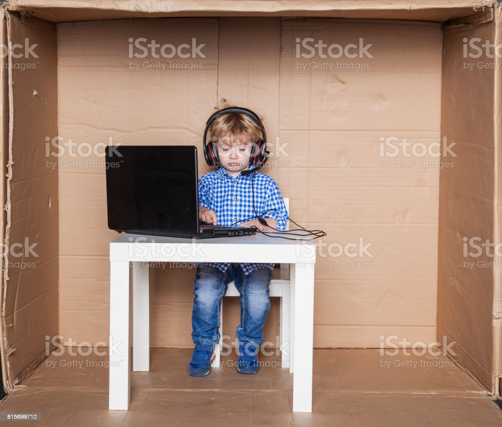 sad boy working in a corporate office, small businessman stock photo