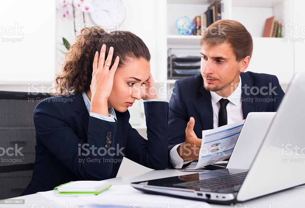 sad business colleagues in office stock photo