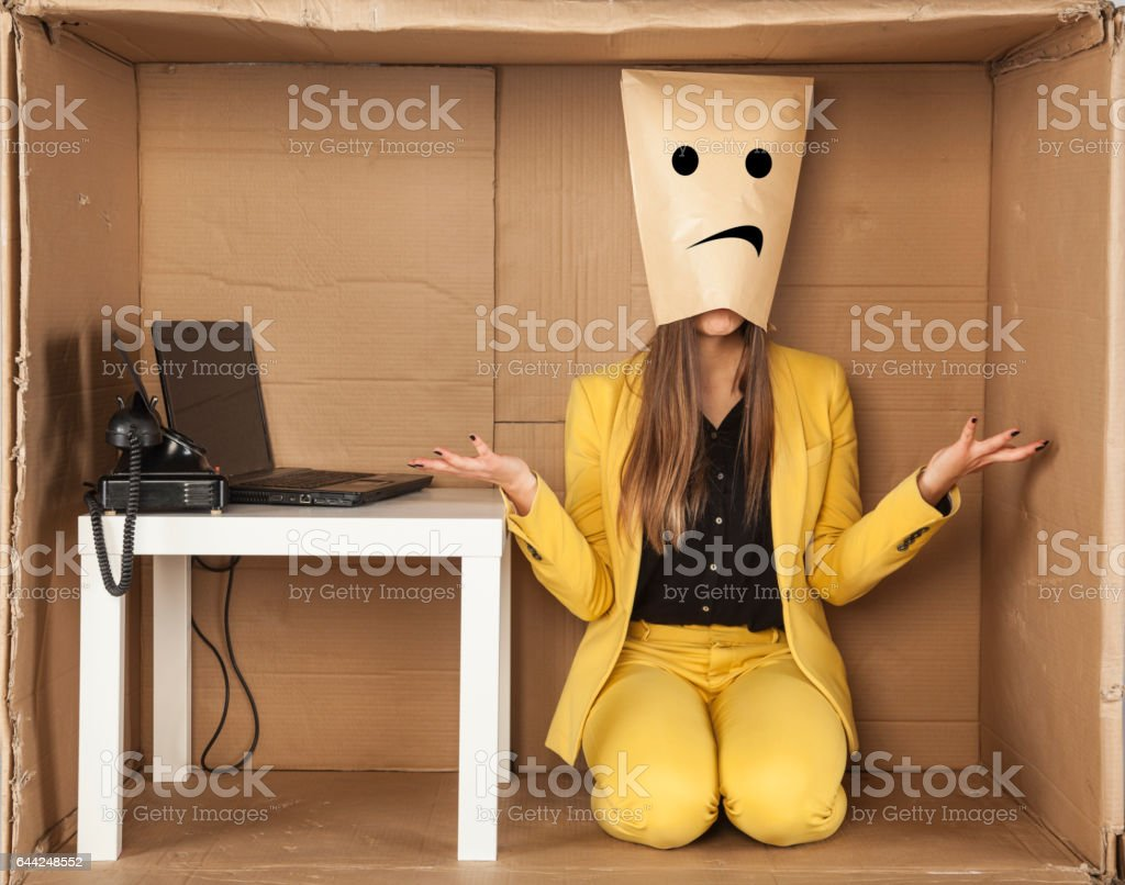 Sad business woman donned a paper mask stock photo