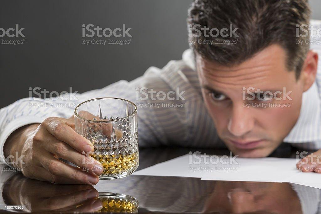 Sad businessman drinking alcohol royalty-free stock photo