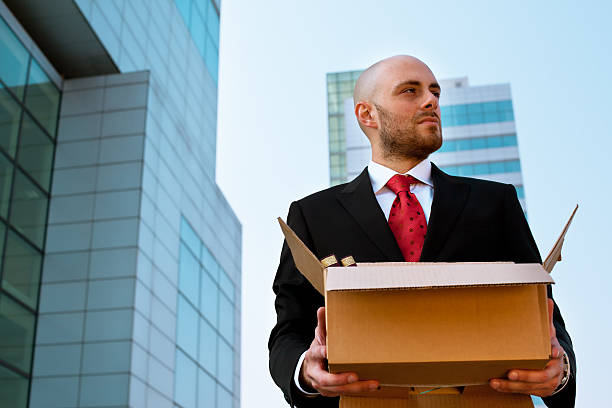 Sad Businessman Fired from Work stock photo