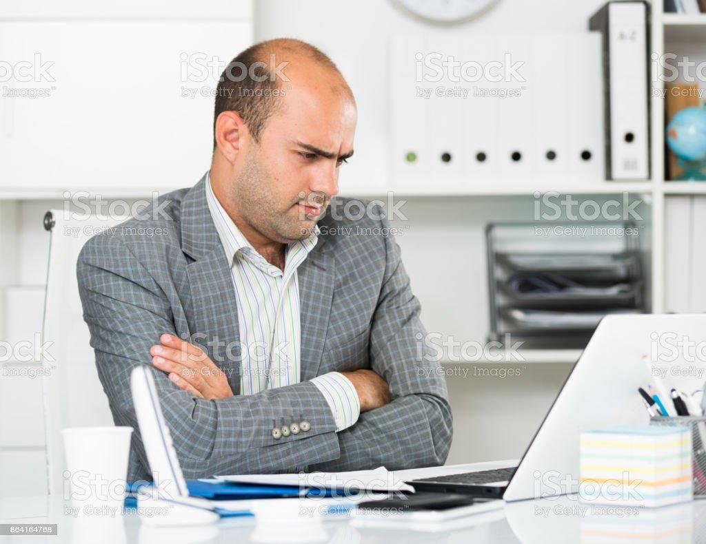 Sad businessman thinking about work royalty-free stock photo