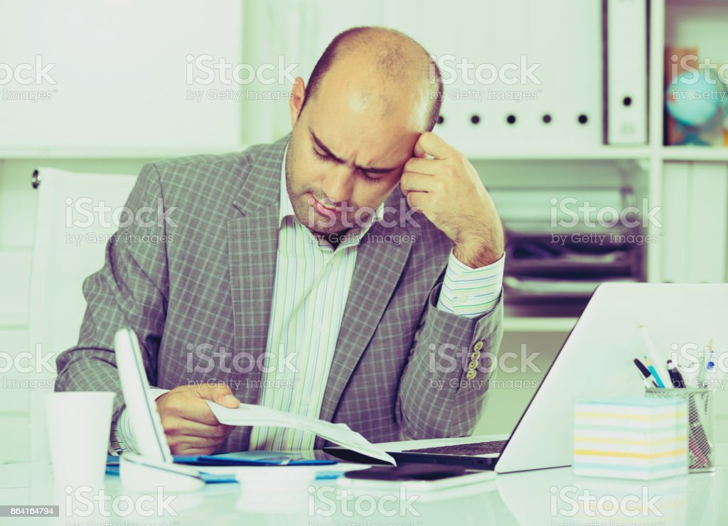 Sad businessman thinking about work royalty-free stock photo