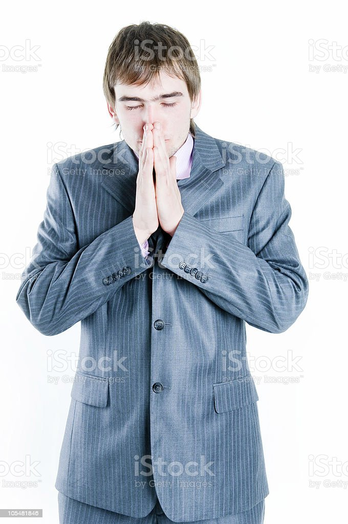 Sad businessman with hands clasped together royalty-free stock photo