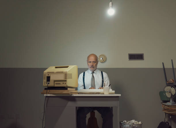 Sad businessman working in a small office stock photo