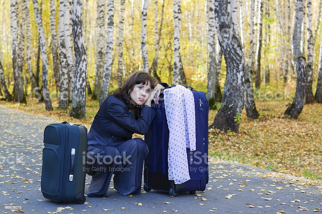 Sad businesswoman with a luggage royalty-free stock photo