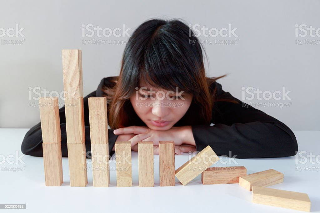 Sad businesswoman with simulate stock market took a nosedive stock photo