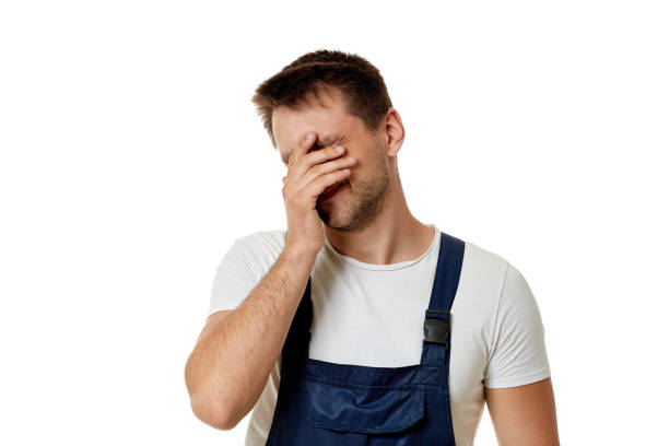 sad caucasian worker repairman - deplorable stock pictures, royalty-free photos & images
