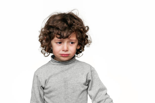 Sad child over white background stock photo