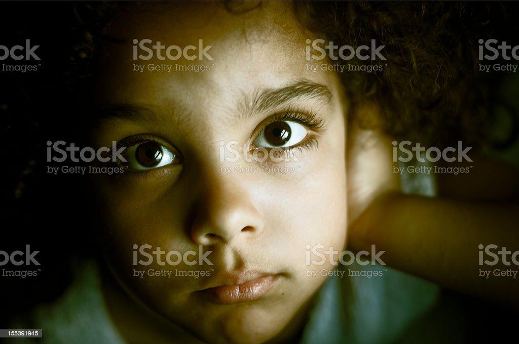 Sad Child (5-6) Portrait Looking Upwards stock photo