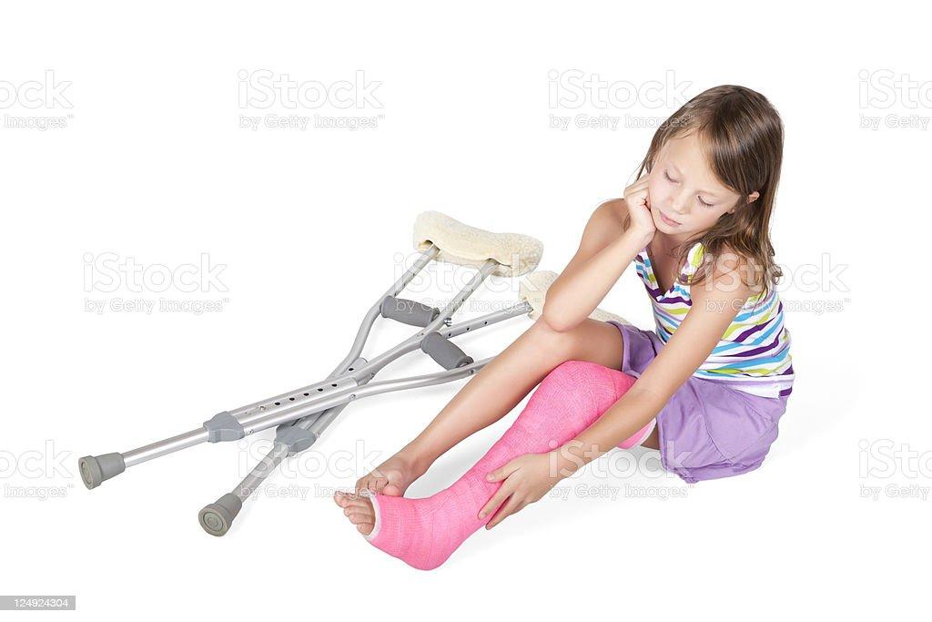 Sad child with pink leg cast stock photo