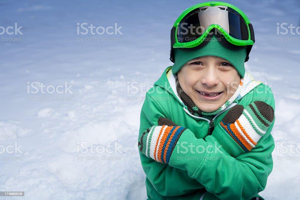 Sad cold boy snowboarder stock photo