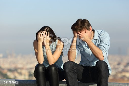 istock Sad couple complaining after argument outdoors 1091787912