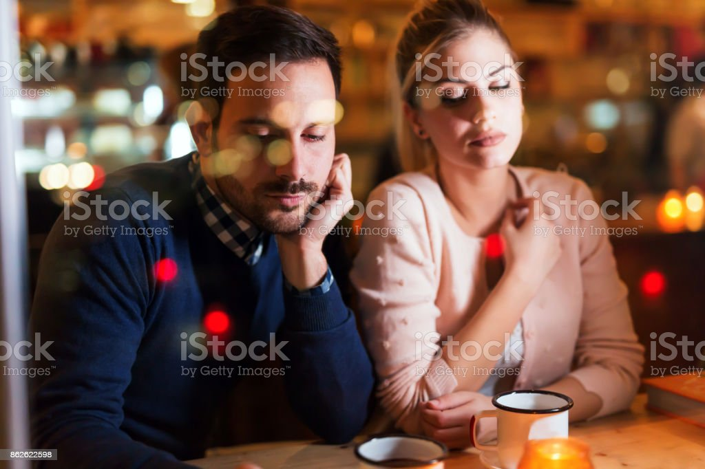 Sad couple having conflict and relationship problems stock photo