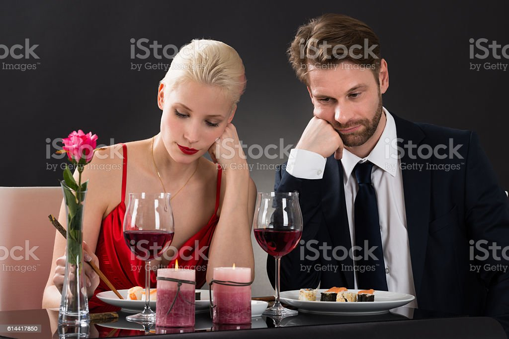 Sad Couple Having Dinner At A Restaurant stock photo