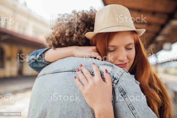 Sad Couple Hugging While Saying Goodbye Stock Photo - Download Image Now
