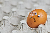 istock Sad cracked egg in paper egg tray 1282734508