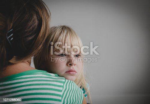 sad crying little girl hugging mother, parenting and protection