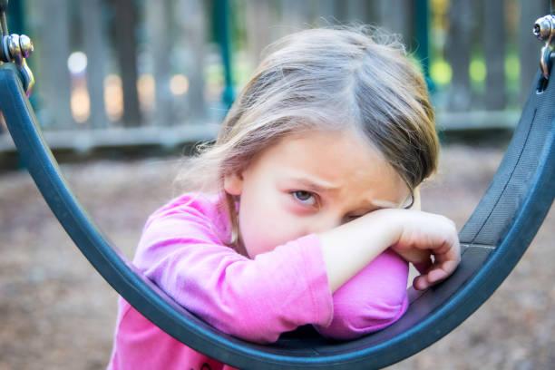Sad crying little girl stock photo