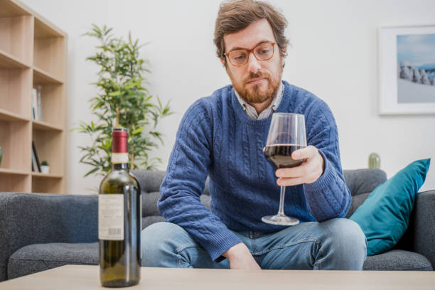 Sad depressed addicted drunk guy having problem stock photo