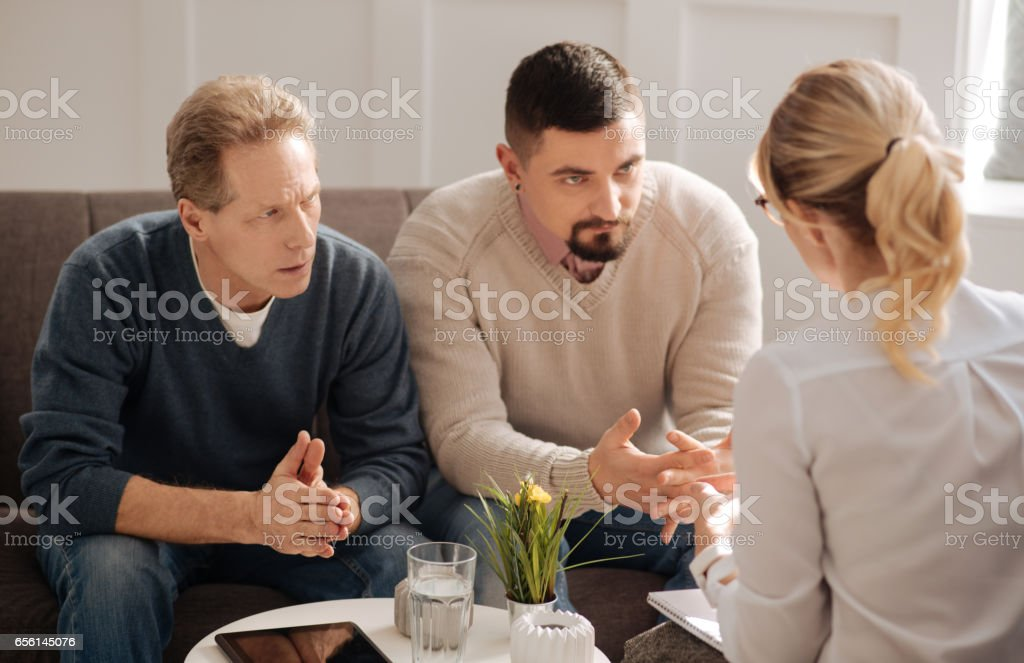 Sad depressed gay couple saving their relationships stock photo