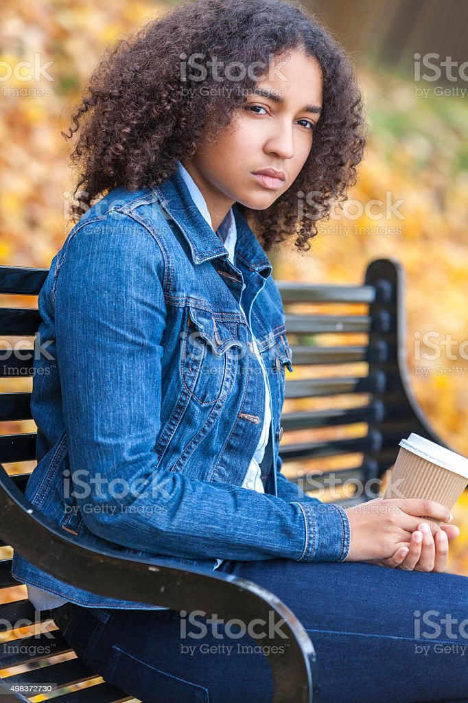 Sad Depressed Mixed Race Teenager Woman Drinking Coffee stock photo