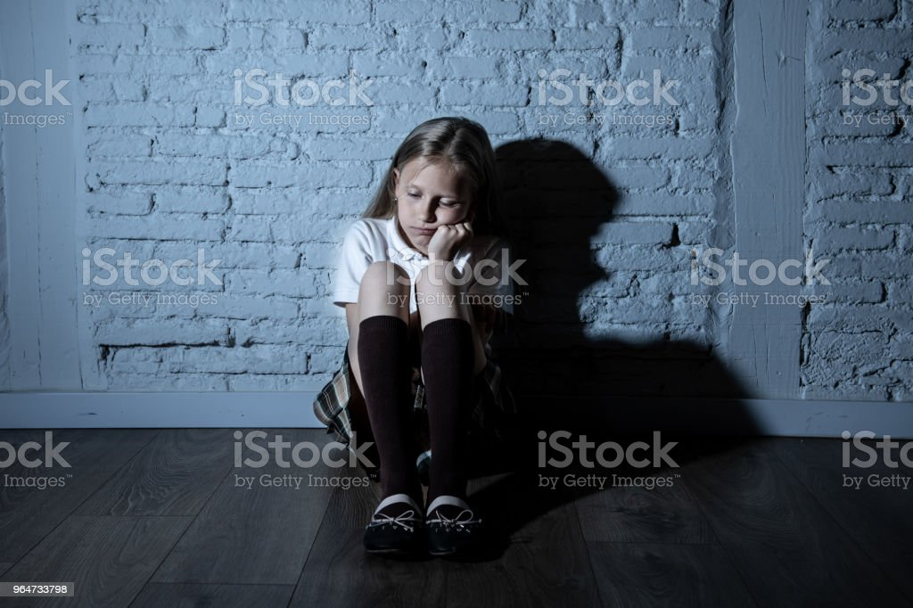 Sad desperate young girl suffering from bulling and harassment at school royalty-free stock photo