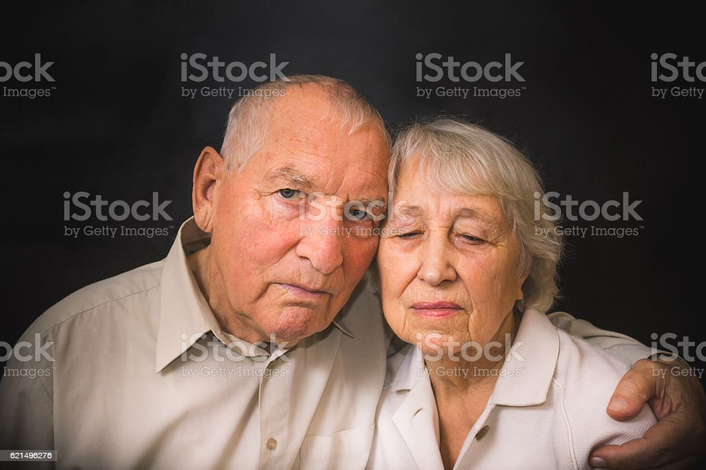 Sad elderly couple on a black background foto stock royalty-free