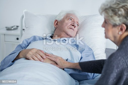 902077950istockphoto Sad elders at hospital 932299354