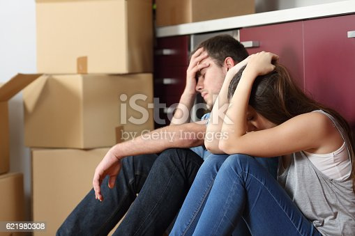 istock Sad evicted couple worried moving house 621980308