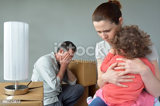 istock Sad evicted family worried relocating house. 690243814