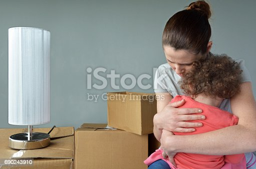 istock Sad evicted mother with child worried relocating house 690243910