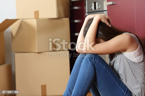 istock Sad evicted woman worried moving house 621981164
