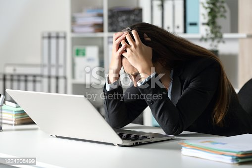692461598 istock photo Sad executive complaining on her desk at the office 1224208499