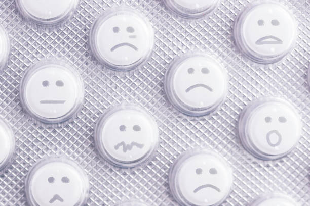 sad face of pills - deplorable stock pictures, royalty-free photos & images