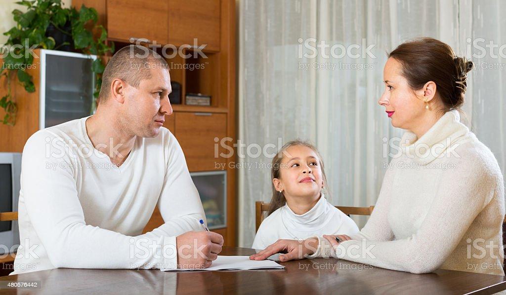 Sad family having financial problems stock photo