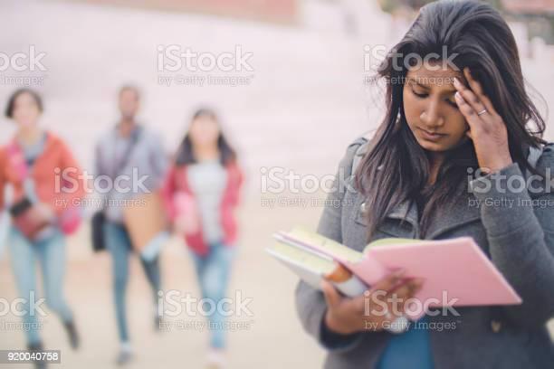 Sad female college student holding her head and reading book picture id920040758?b=1&k=6&m=920040758&s=612x612&h=iiktq6tctudlvnlvbnv8uqio1gtxifdx99xtq9rtpzo=