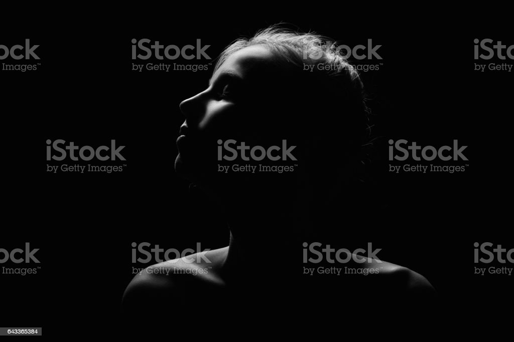 sad female profile stock photo