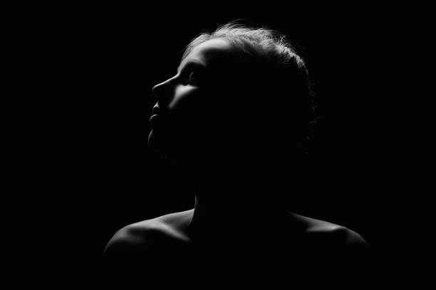 sad female profile - high contrast stock pictures, royalty-free photos & images
