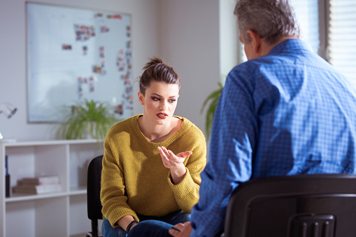 Sad Female Student Sharing Problems To Therapist Stock Photo - Download Image Now