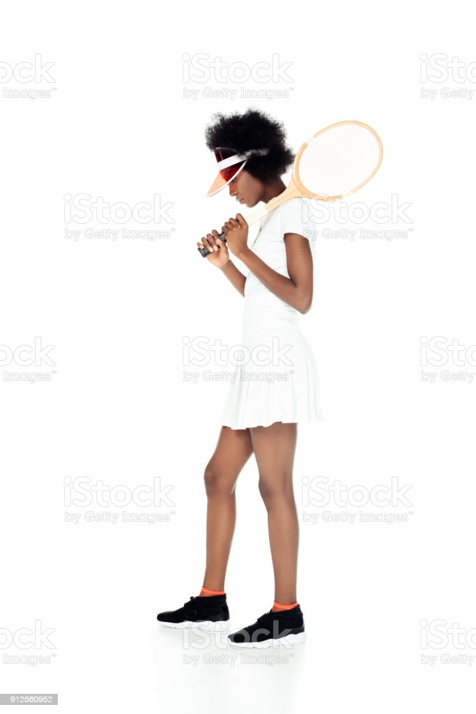 sad female tennis player with racket isolated on white stock photo