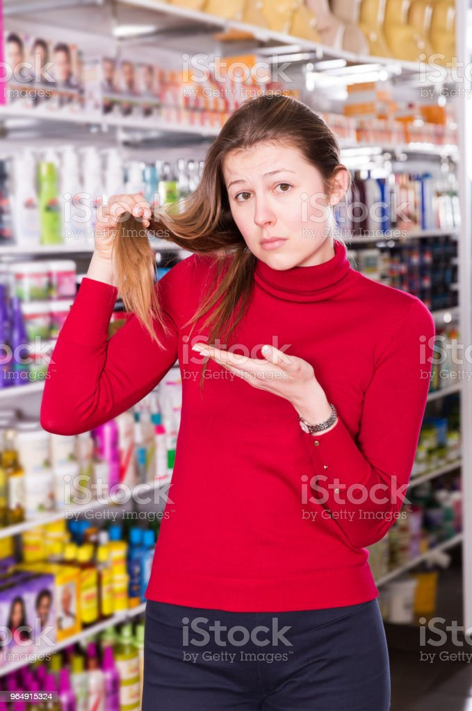 sad female who is dissatisfied of her hair royalty-free stock photo