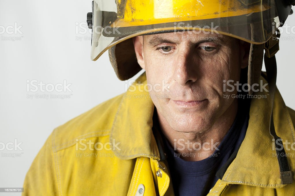 Sad Fireman Looking Down, With Copy Space royalty-free stock photo